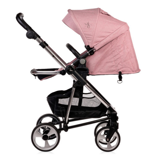 Amy Childs Roma Vita Pink Travel System The Roma Vita travel system includes everything you need for your baby. The package includes the Vita stroller, carrycot, car seat, changing bag, footmuff and raincover. The Vita chassis features lockable swivel front wheels and a compact, self-standing fold. An ergonomically shaped handle complements the leatherette bumper bar.